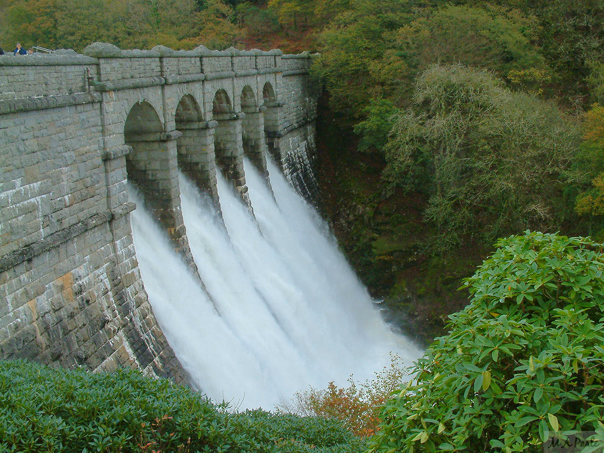 Water cascades over the Burrator Dam wall